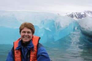 Woman in life preserver in front of an iceberg